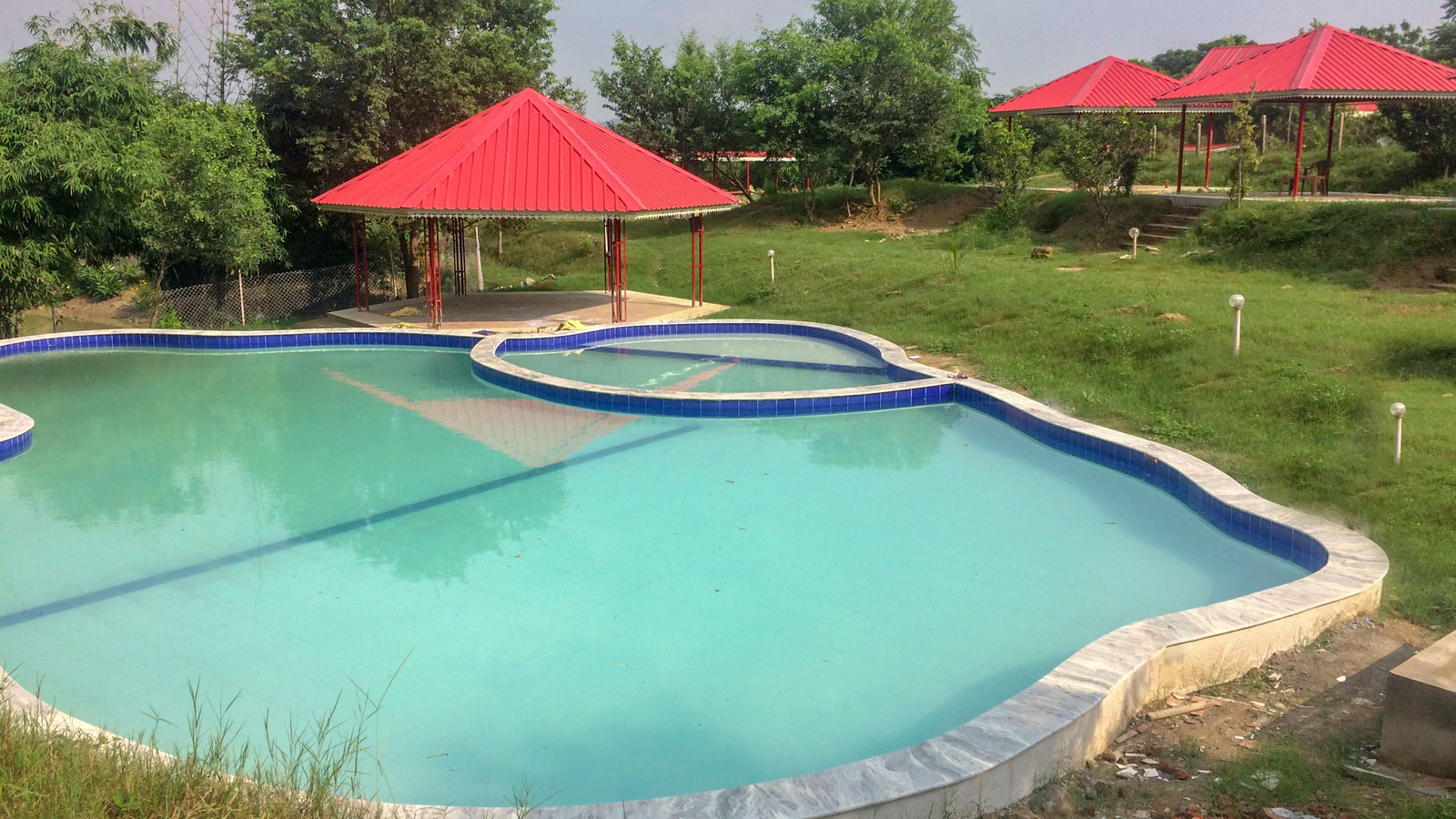 Enjoy Swimming in the Pool at Prakriti Farms